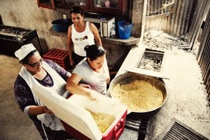 Women from Costa RIca making a traditional dish Arroz con pollo  (chicken with rice)